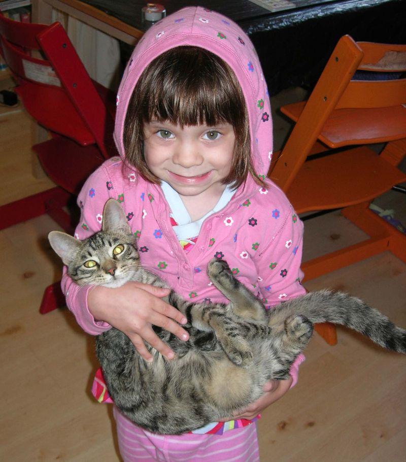 Kitty holding isaac