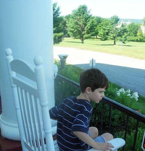 Jack in rocking chair on Resort porch